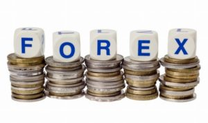 Stacks of coins with the word FOREX isolated on white background